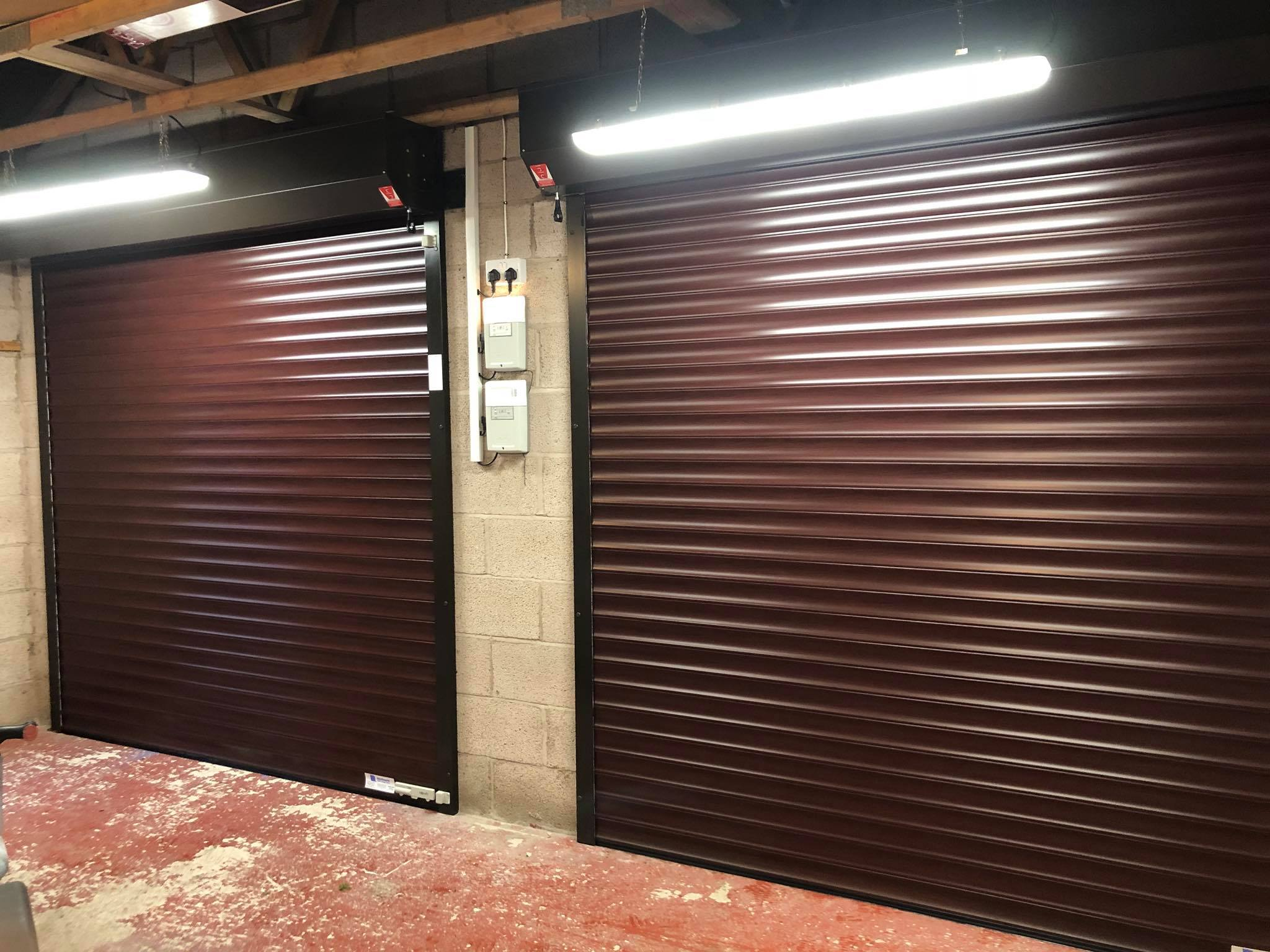 Double brown garage doors, learn more about what barrett garage doors can do for you