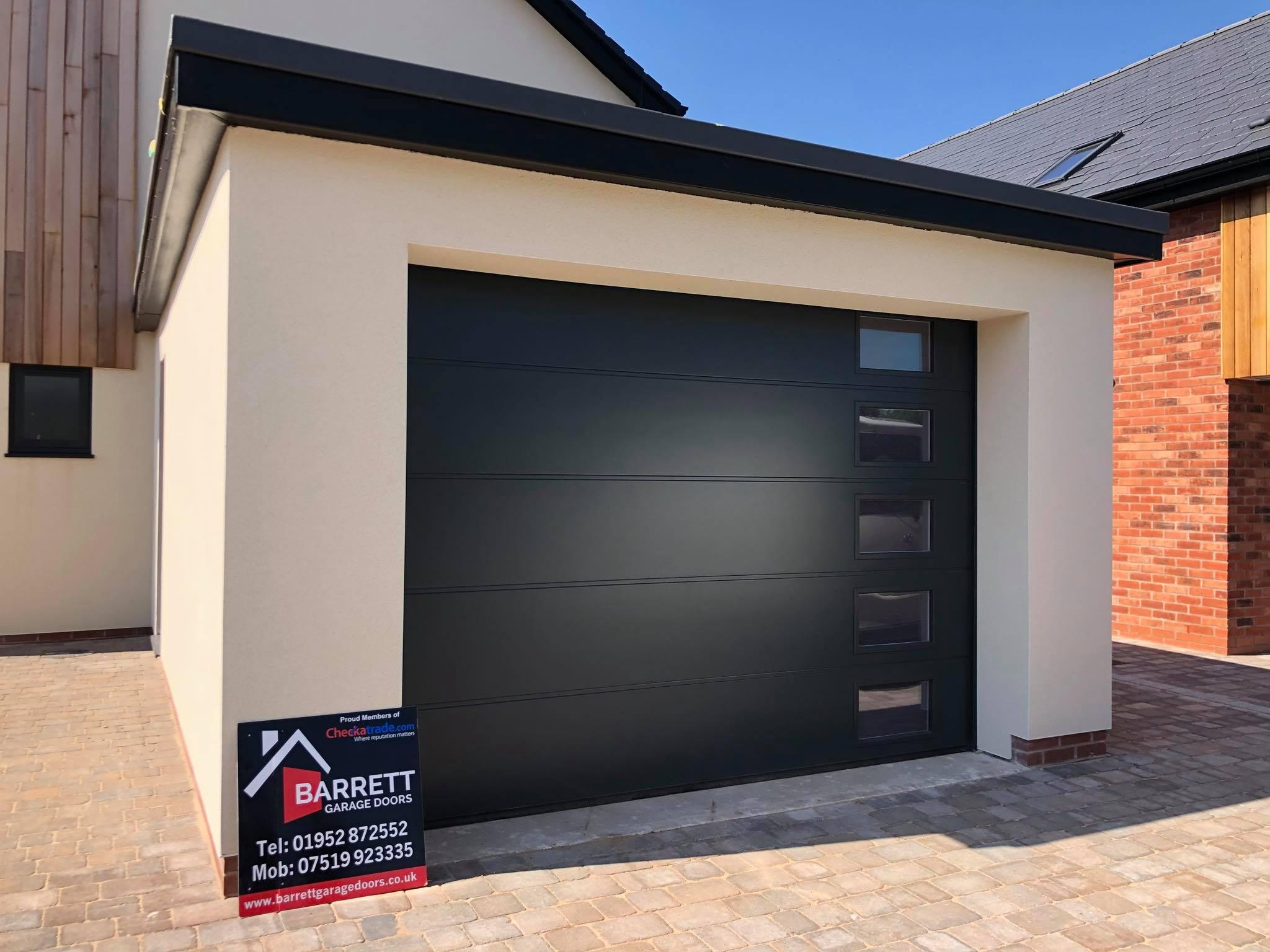 Single up and over garage door in grey